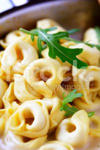 stock-photo-14194188-closeup-of-cream-sauce-with-tortellini-on-saucepan